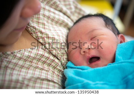Asian mother and newborn baby girl in hospital - stock photo