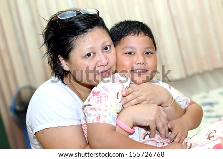 Asian mother and son.