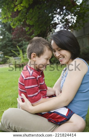 Asian mother and son laughing - stock photo