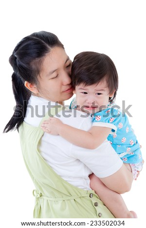 Asian mother carrying  and soothe her daughter,child crying ,isolated on white background - stock photo