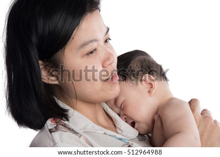 Asian mother holding little crying baby infant with love