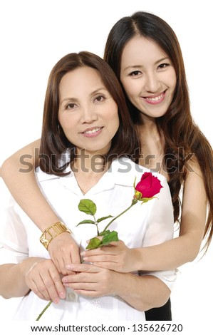 Asian mother holding rose flower with her daughter isolated on white background - stock photo