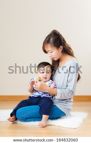Asian mother play toy block with her son - stock photo