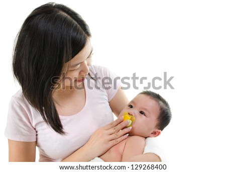 Asian mother trying to calm her crying baby boy isolated on white background - stock photo