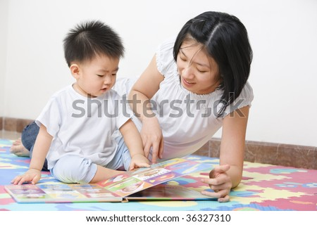 Asian mother tutoring her son for early education