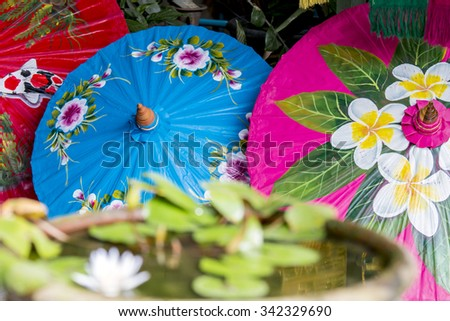 Asian multi-colored umbrellas made of paper in traditional style handmade in Thailand - stock photo