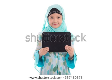 Asian muslim girl holding tablet on white background isolated - stock photo