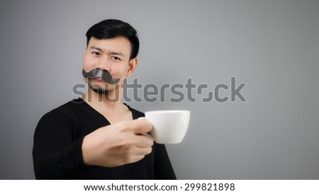 Asian mustache man holding cup with grey background.