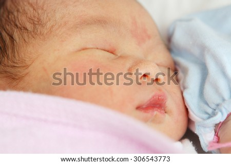 Asian Newborn Baby Girl Sleeping Isolated on White Background.