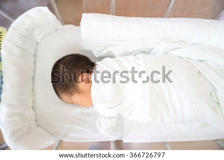 Asian newborn baby in hospital, delivery room