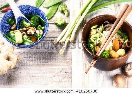 Asian noodles with stir-fried vegetables. Food background with copy space - stock photo