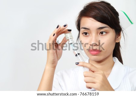 Asian nurse preparing medicine in a vial