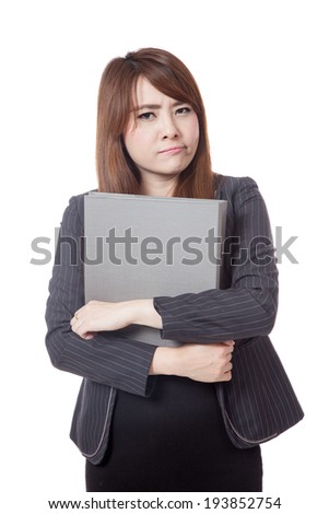 Asian office girl unhappy hold a folder in her arms isolated on white background