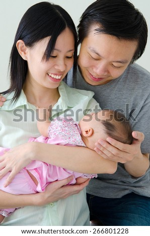 Asian parent and their new born baby - stock photo