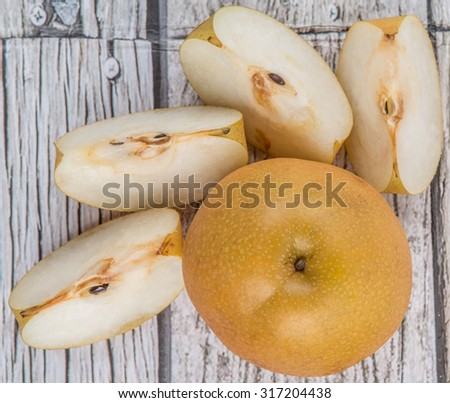 Asian pear, also known as Nashi pear over wooden background - stock photo