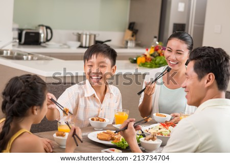 Asian people having fun at the family dinner - stock photo