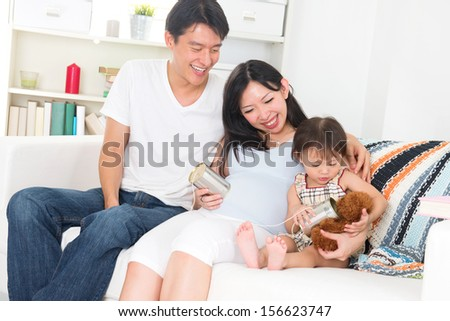 asian pregnant couple enjoying quality time with family