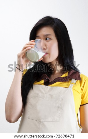 Asian pregnant woman drinking milk