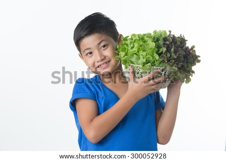 Asian pretty boy hold vegetables salad in basket - stock photo
