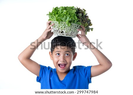 Asian Pretty boy Holding vegetables on head - stock photo
