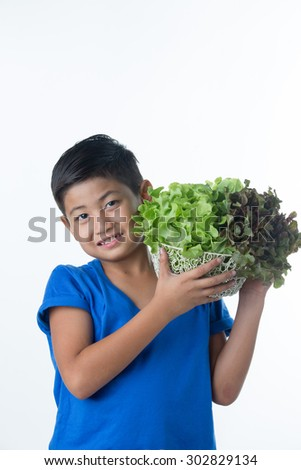 Asian pretty boy holding vegetables salad in basket - stock photo
