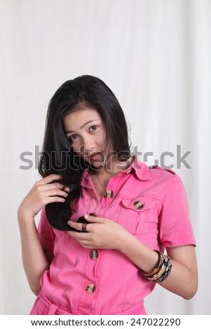 asian pretty girl touching her long hair - stock photo