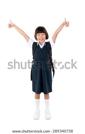 Asian primary school girl raised her thumbs up. Education concept. - stock photo
