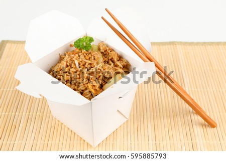Asian rice with vegetables in a box