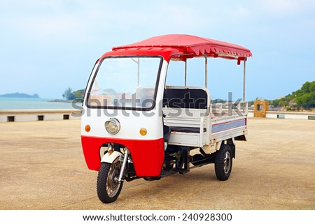 asian rickshaw vehicle parked on the road - stock photo