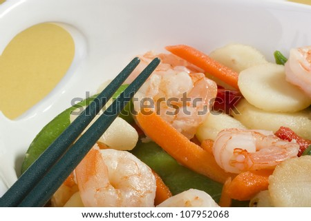 Asian salad in a white bowl with green chopsticks. - stock photo