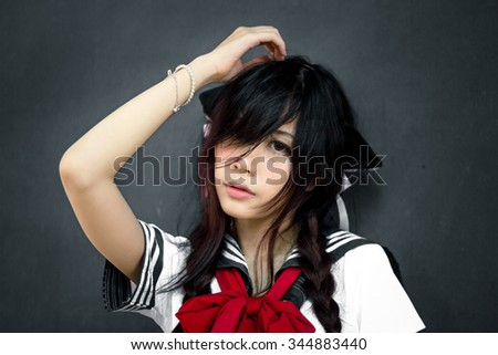 Asian school girl with charming eyes