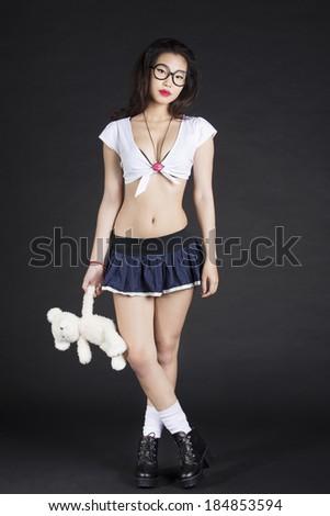 Asian School girl with Teddy Bear - stock photo