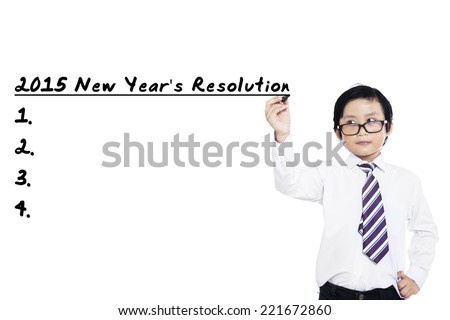 Asian schoolboy writes resolutions list in 2015 on whiteboard
