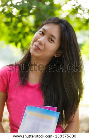Asian schoolgirl in outdoor - stock photo