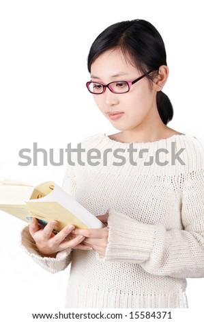 asian schoolgirl studying, isolated on white. - stock photo