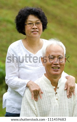 Asian Senior Couple at outdoor park, focus on the man