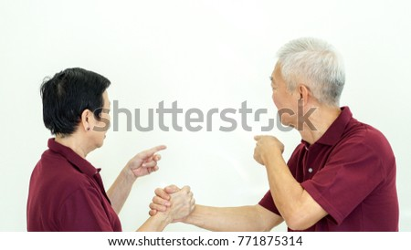 Asian senior couple checking on information white background copy space