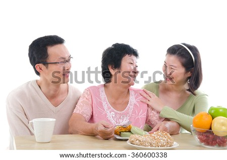 asian senior female dining - stock photo