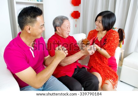 Asian senior man and children celebrating chinese new year