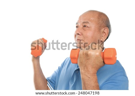 Asian senior man doing exercise with dumpbells - stock photo
