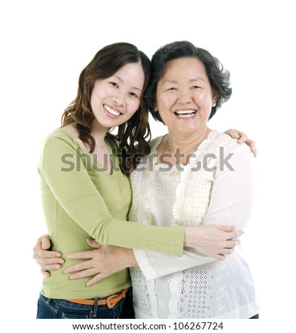 Asian senior woman and daughter - stock photo