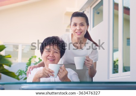 Asian senior woman and daughter relax in the garden