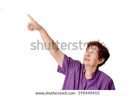 Asian Senior woman pointing with white background.