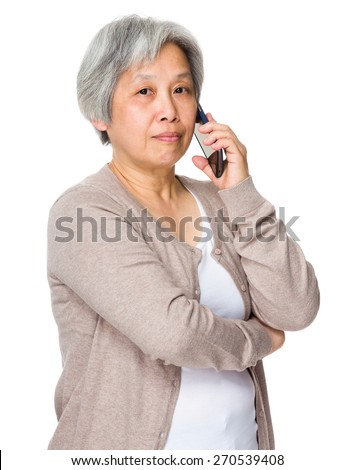 Asian senior woman use of mobile phone - stock photo