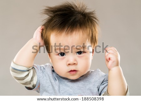 Asian serious kid with grey background - stock photo