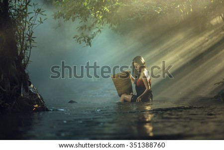 Asian sexy woman bathing in cascade, Thailand - stock photo