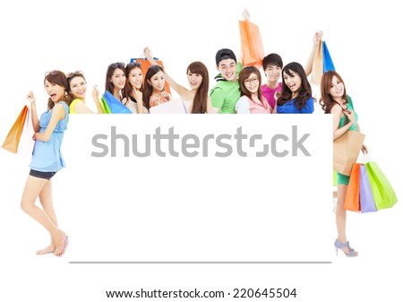 asian shopping women group holding color bags with a white board