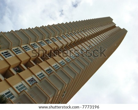 Asian skyscraper to the cloudy blue sky - stock photo