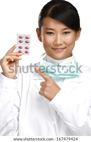 Asian smiling femal doctor showing pills treatment on white