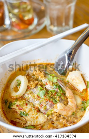 Asian spicy seafood noodle soup with shrimp and mantis shrimp delicious Thai food. - stock photo
